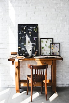 Workspace of Florist with Dry Flowers Name List on Black Board