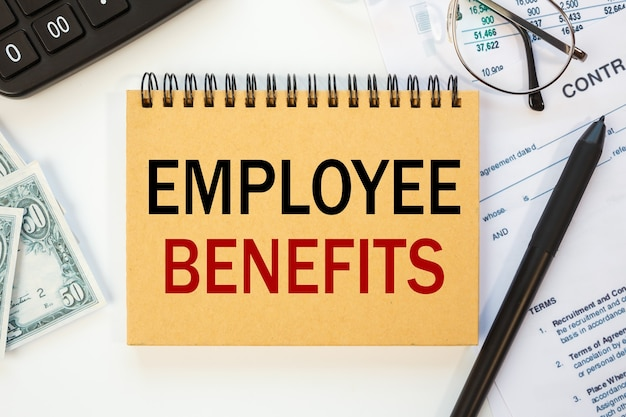 Workspace office desk and notebook writing employee benefits