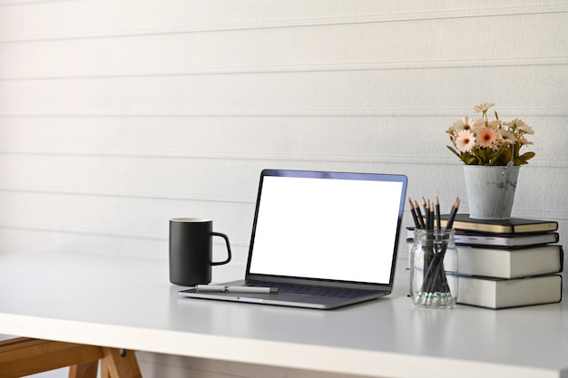 Workspace with blank screen laptop.