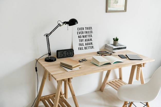 Workspace with books and wooden table