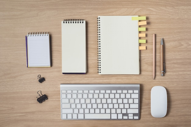 Workspace with diary or notebook and clipboard, mouse, keyboard, pencil, sticky notes