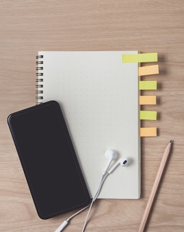 Workspace with diary and smartphone