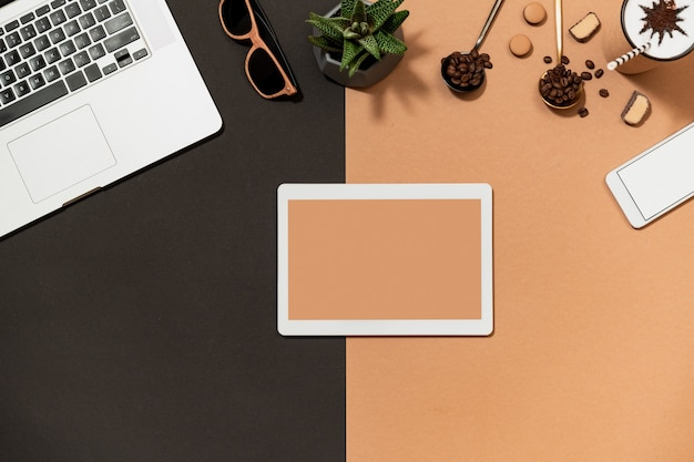 Workspace with digital device flat lay