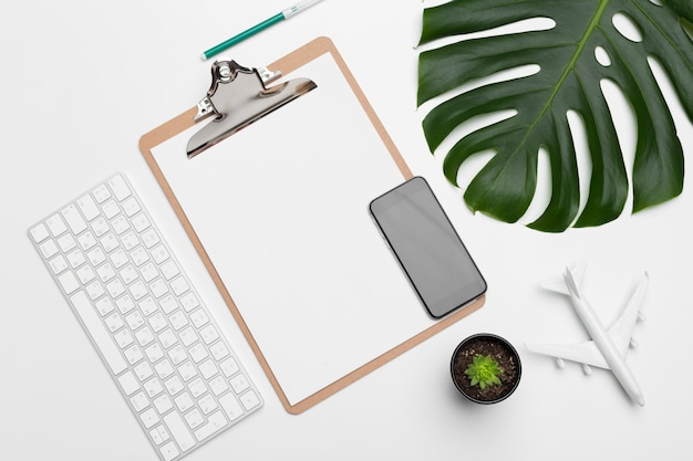 Workspace with keyboard, palm leaf and accessories. flat lay, top view