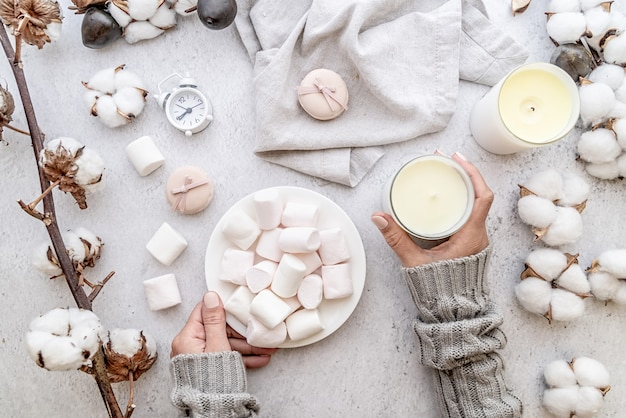 Workspace with marshmallows, cotton and candles