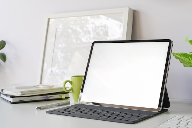 Workspace with mockup blank screen tablet