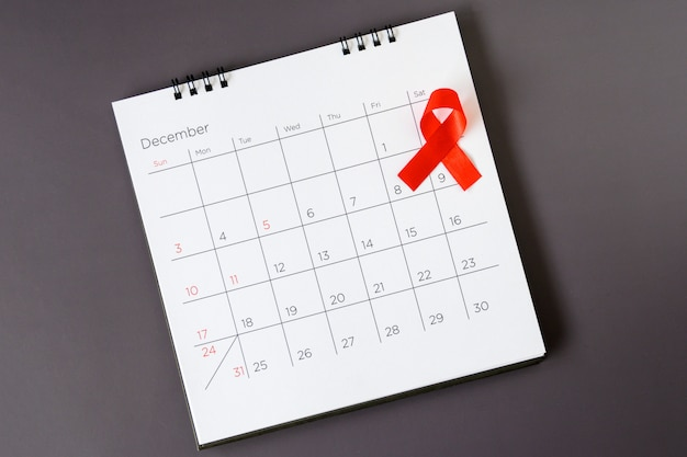 World aids day concept, red ribbon the date 1 december