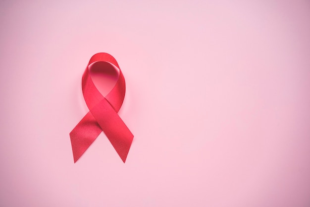 World cancer day and breast cancer day concept, red ribbon awareness symbol