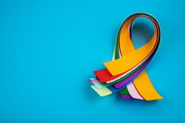 World cancer day february 4th. multi-colored ribbons, symbols of the disease. medical concept.