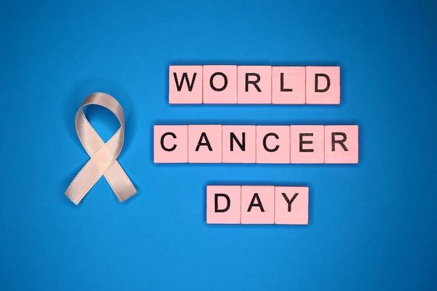 World cancer day. ribbon on blue background. february 4