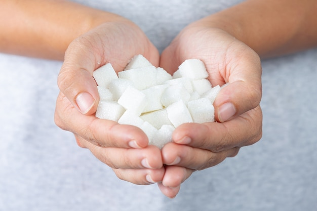 World diabetes day; hand holding sugar cubes