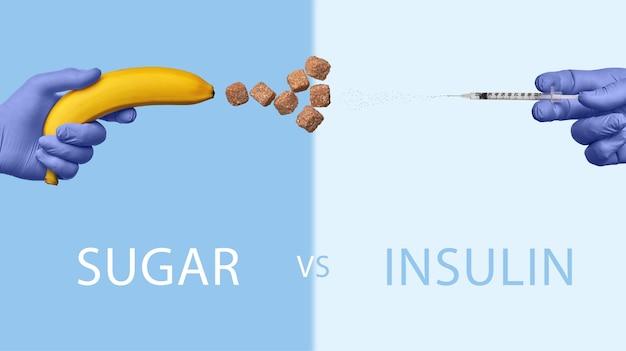 世界糖尿病デー。砂糖で発射するバナナに対してインスリンを発射する注射器。砂糖対インスリン
