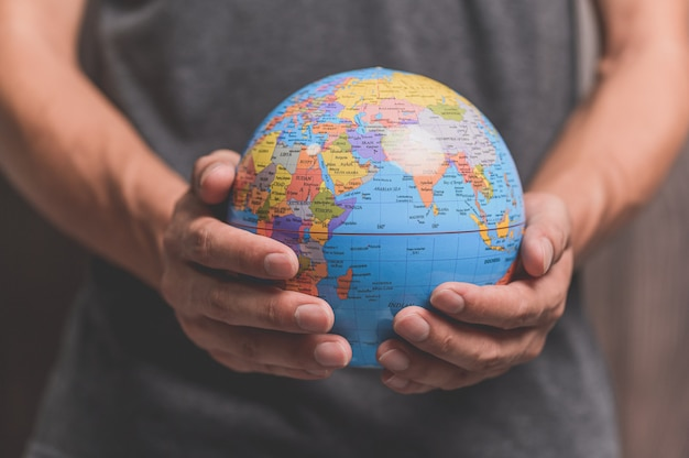 World environment day .love the world .hand holding a globe