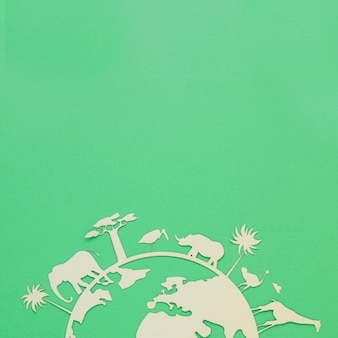 World environment day wooden object on green background with copy space