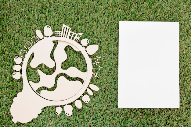 World environment day wooden object with empty card on grass