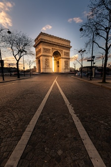 World famous arc de triomphe at the city center of paris, france.