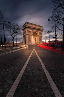 World famous arc de triomphe at the city center of paris, france.