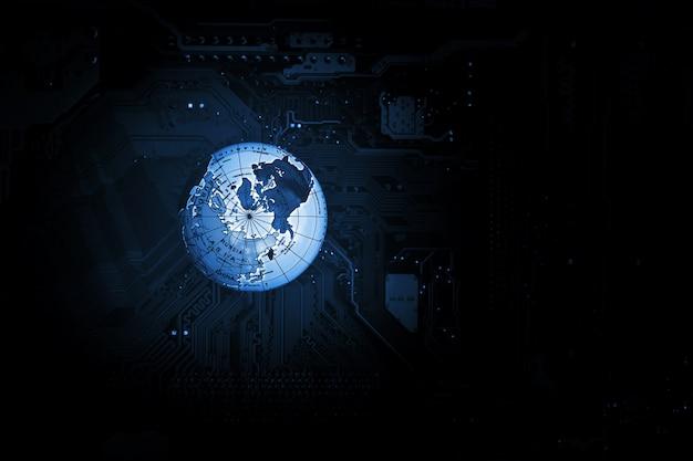 World globe on computer circuit board in the dark.
