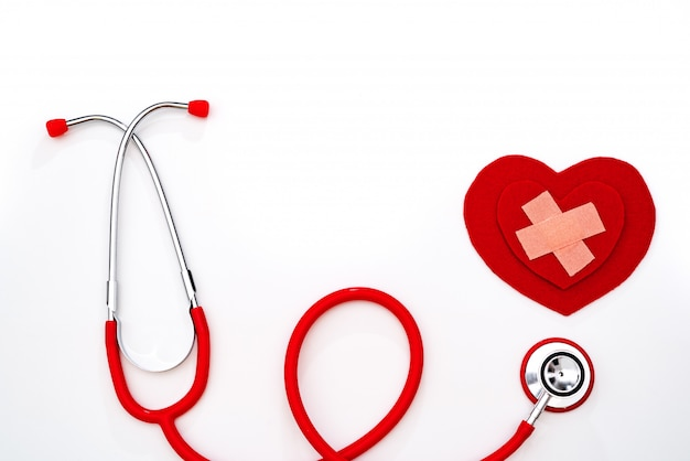 World health day, healthcare and medical concept, red stethoscope and red heart on white background