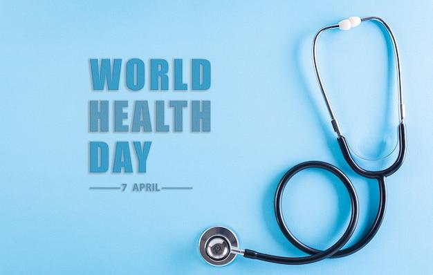Всемирный день здоровья. стетоскоп на пастельно-синем цвете с текстом.