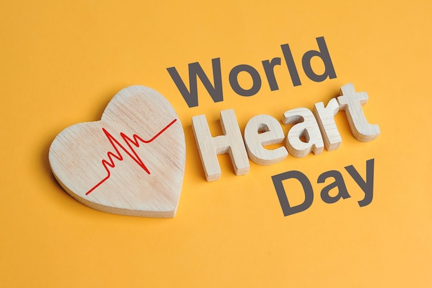 World heart day concept shape heart symbol and heart text created off wood