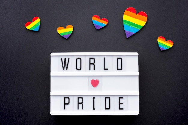 World love pride quote with rainbow hearts