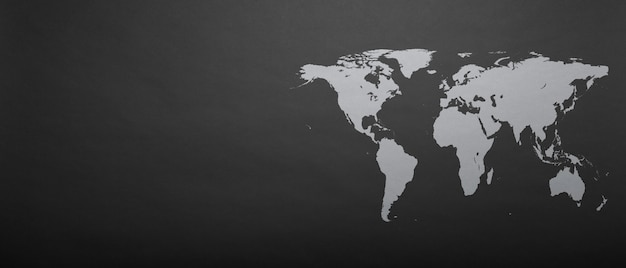 A world map on grey paper background