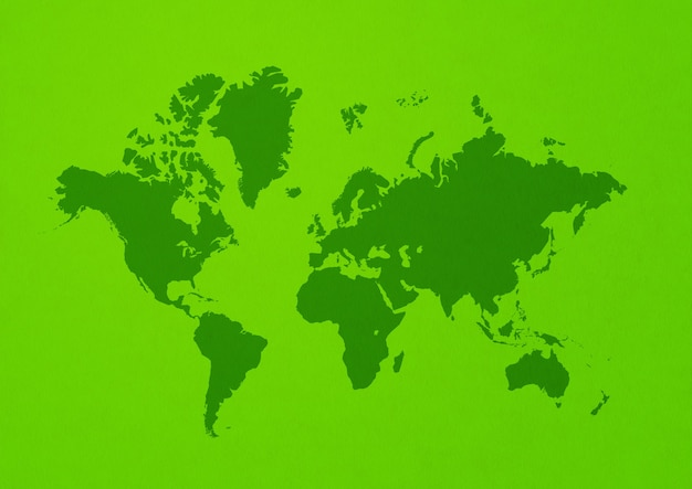 World map isolated on green wall background