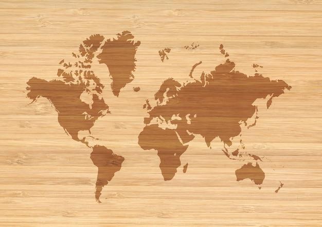 베이지 색 나무 벽 배경에 고립 된 세계지도입니다.