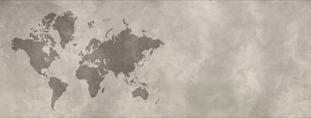 コンクリートの壁の背景に分離された世界地図。横バナー