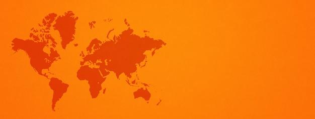 World map isolated on orange wall surface