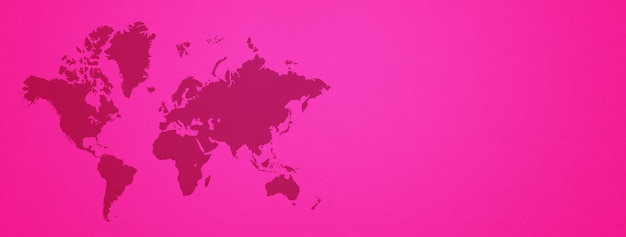 World map isolated on pink wall background. horizontal banner