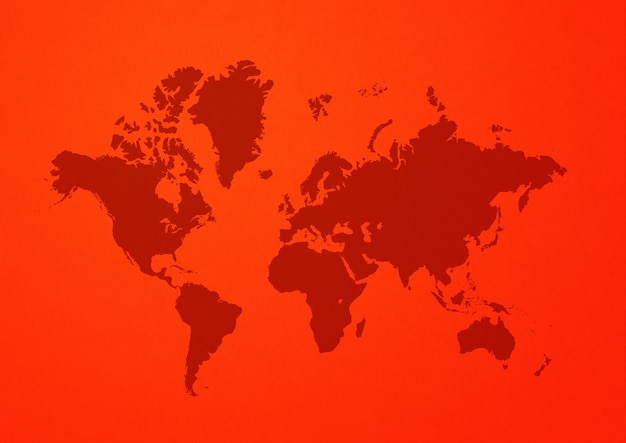 World map isolated on red wall background