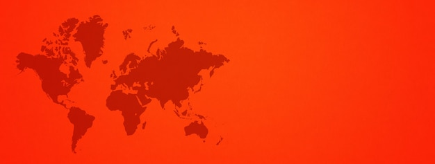 World map isolated on red wall surface