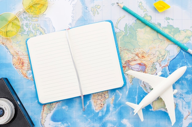 World map with travelling notebook