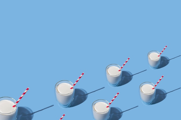 World milk day. glass of milk with a red straw against a blue background. seamless pattern. sample. package. layout.