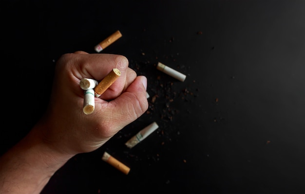 World no tobacco day concept. cigarettes in the hands of men