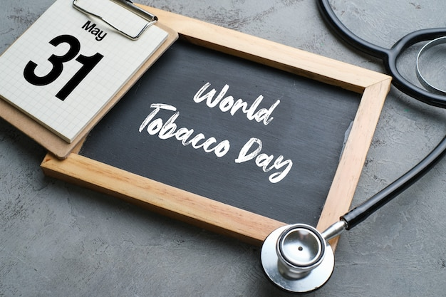 World no tobacco day lettering over chalkboard background. stop smoking concept