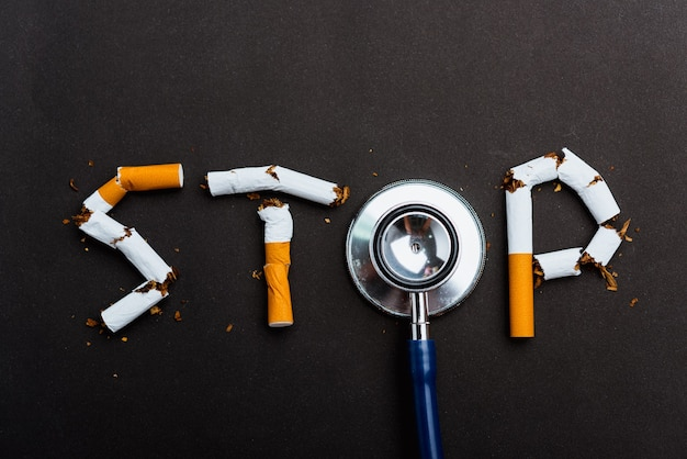 World no tobacco day no smoking close up word stop spelled text of the pile cigarette or tobacco