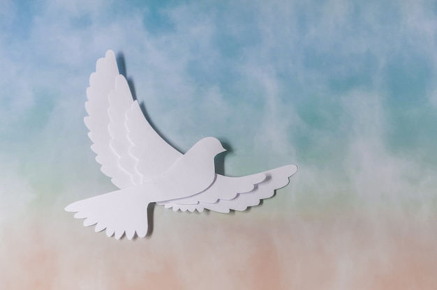 World peace day greeting card template. white dove flying on sky.