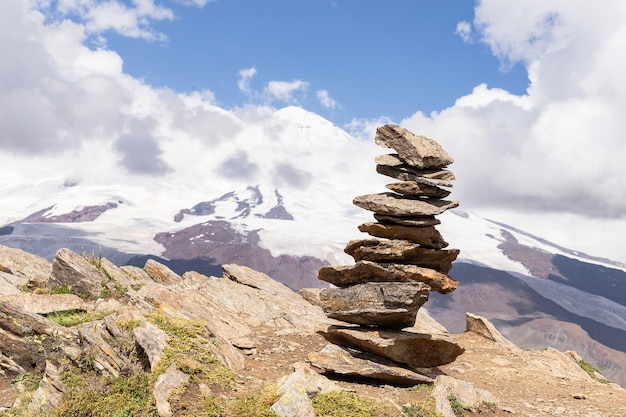 World tourism day, pyramid of stones on the slope of mount cheget