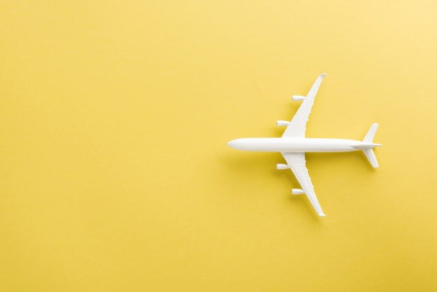 World tourism day top view flat lay of minimal toy model plane airplane