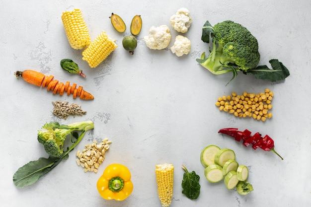 World vegan day. frame of fresh vegetarian various ingredients for cooking vegan plate overhead view