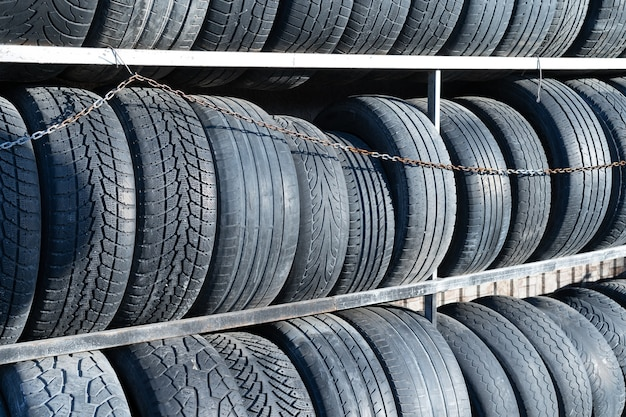 Worn out car tires on shelves