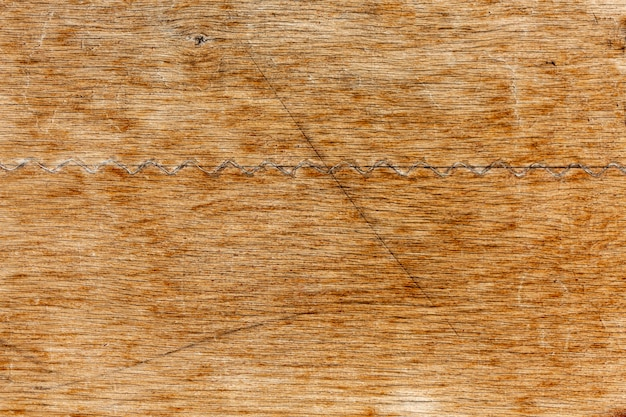Worn wood surface with scratches
