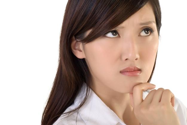Worried business lady face, closeup portrait of oriental woman.