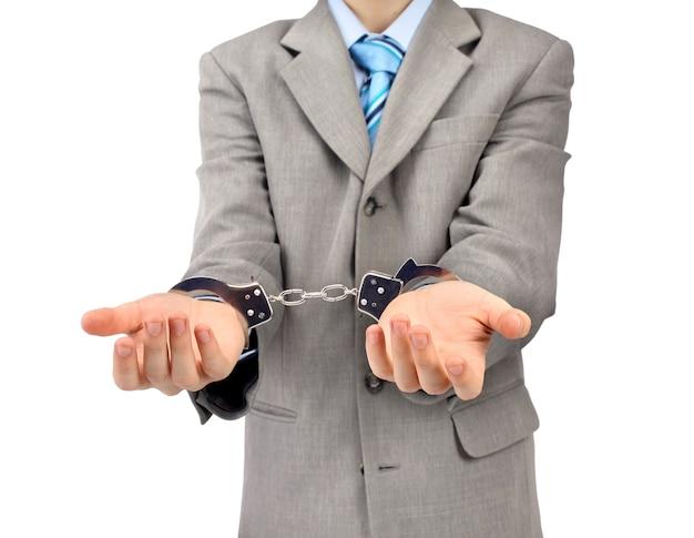 Worried caucasian middle aged businessman in handcuffs . studio shot. white background