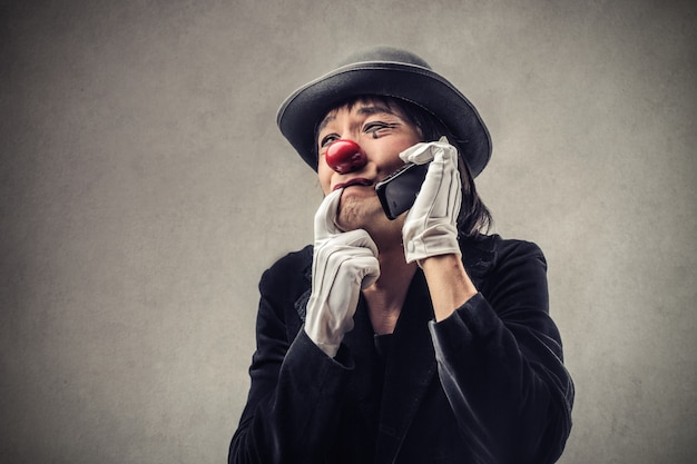 Worried clown talking on the phone
