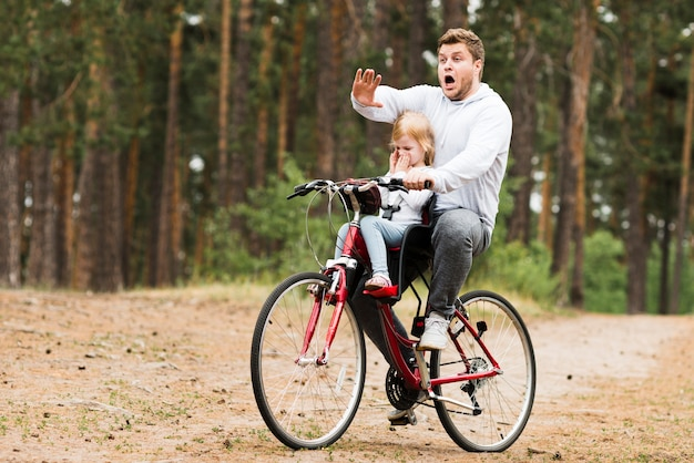 Worried father and daughter on bicycle