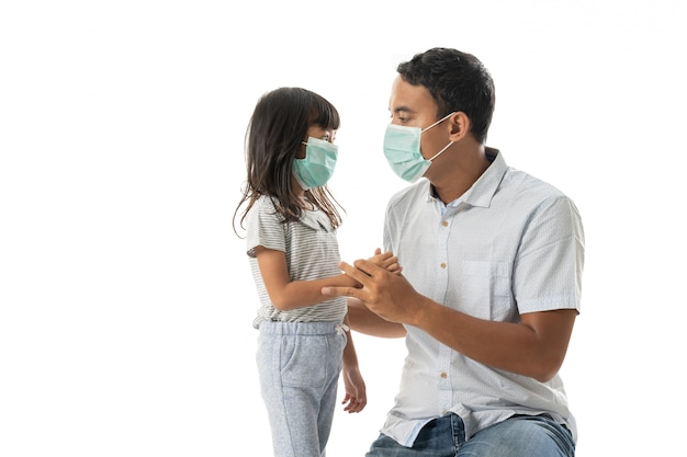 Worried father and daughter wearing face mask